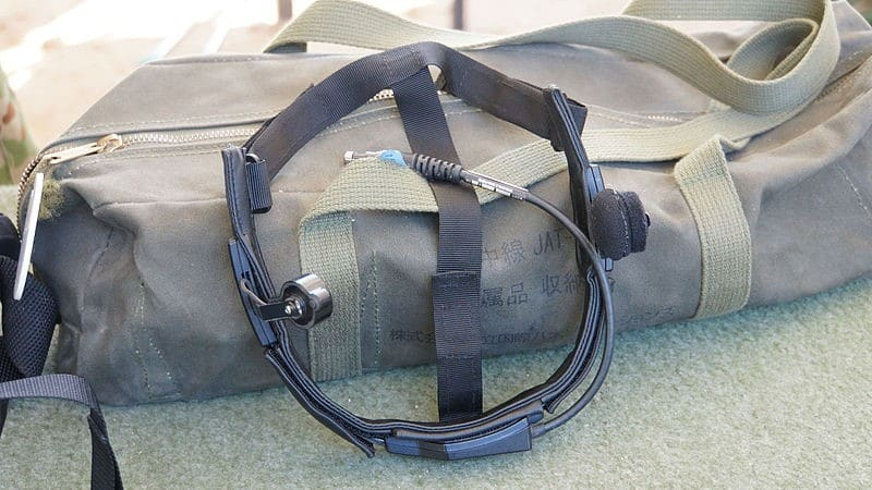 Bone conduction headphones on top of a military duffle bag